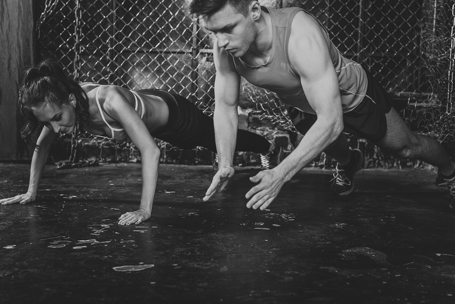 man and woman doing pushups